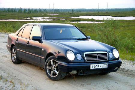 NOVYY URENGOY, RUSSIA - JULY 15, 2016: Motor car Mercedes-Benz W210 E240 at the countryside. Éditoriale
