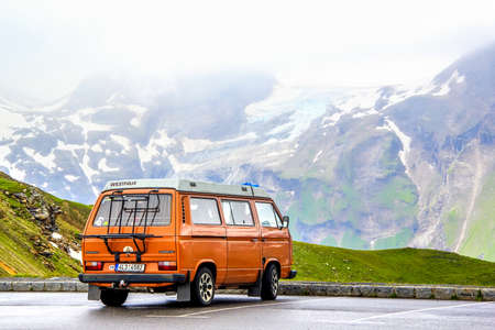 TYROL, AUSTRIA - JULY 29, 2014: Blue classic van Volkswagen Caravelle at the parking near the high Alpine mountain road. Редакционное