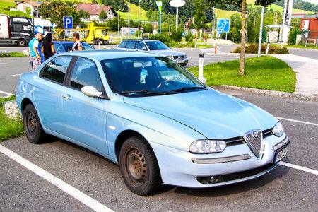 alfa: TYROL, AUSTRIA - JULY 28, 2014: Motor car Alfa Romeo 156 at the interurban road.