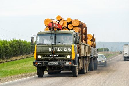 boles: BASHKORTOSTAN, RUSSIA - MAY 8, 2012: Old timber lorry Kamaz 5320 at the interurban road. Editorial