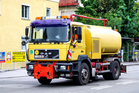 cesspool: INNSBRUCK, AUSTRIA - JULY 29, 2014: Yellow sanitary truck OeAF in the city street.