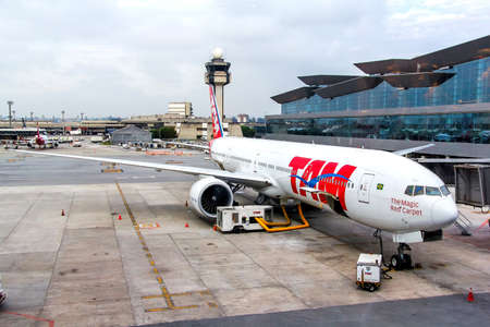 airstrip: SAO PAULO, BRAZIL - NOVEMBER 12, 2015: TAM Airlines Boeing 777 during the boarding in the Guarulhos International Airport.
