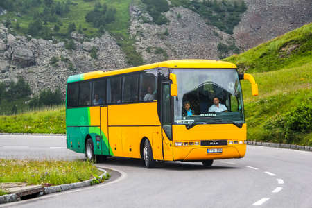 TYROL, AUSTRIA - JULY 29, 2014: Intercity coach MAN S2000 at the Grossglockner high mountain Alpine road.