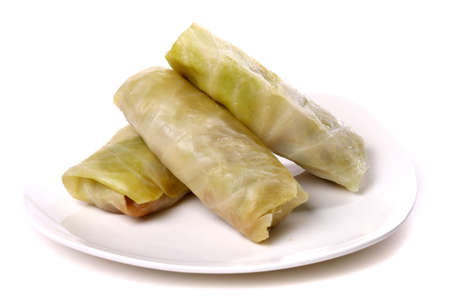 Cabbage rolls filled with ground meat isolated over white background