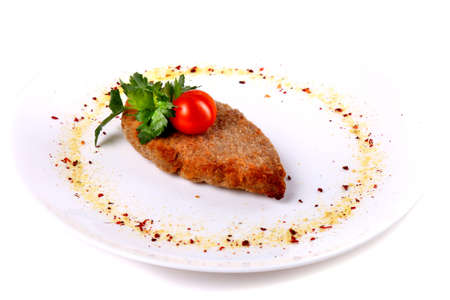 Cutlet with parsley isolated over white background