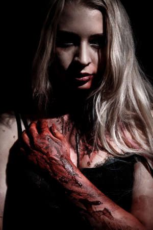 abhorrence: Pale bloody woman over black background
