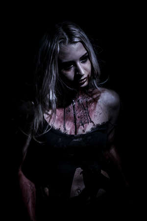 abhorrence: Walking dead woman over black background