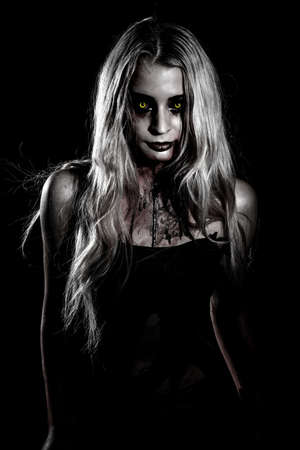 gory: Pale bloody woman with yellow eyes over black background