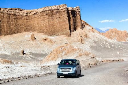 ANTOFAGASTA, CHILE - NOVEMBER 17, 2015: Blue minibus Hyundai H-1 at the background of the Amphitheater of the Moon Valley (Valle de la Luna) in the Atacama desert. Editorial