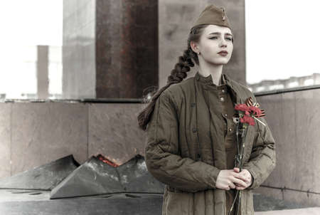 Pretty young girl in a Soviet military uniform 版權商用圖片