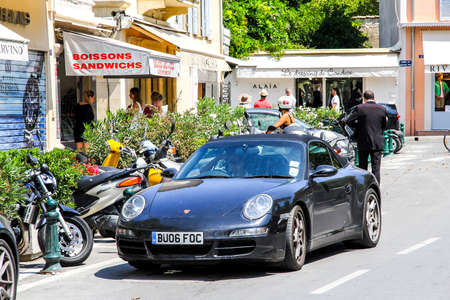 SAINT-TROPEZ, FRANCE - AUGUST 3, 2014: Motor car Porsche 911 (997) in the city street. Editorial