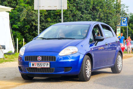 BUDAPEST, HUNGARY - JULY 27, 2014: Motor car Fiat Grande Punto in the city street.