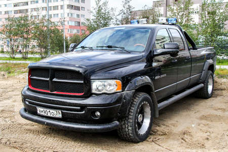NOVYY URENGOY, RUSSIA - AUGUST 15, 2012: Black pickup truck Dodge Ram 2500 in the city street. Editorial