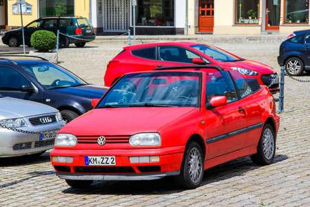 KOENIGSBRUECK, GERMANY - JULY 20, 2014: Motor car Volkswagen Golf in the city street.