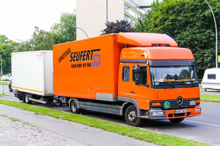 BERLIN, GERMANY - AUGUST 15, 2014: Trailer truck Mercedes-Benz Atego in the city street.