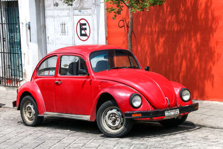 OAXACA, MEXICO - MAY 25, 2017: Red classic vintage car Volkswagen Beetle in the city street.