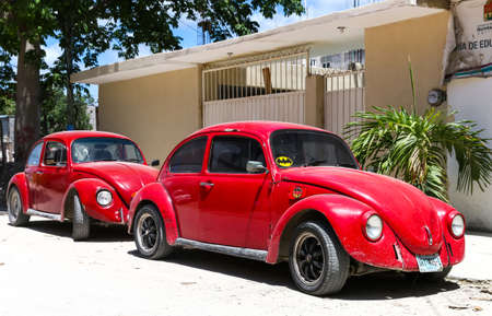 cheapest: TULUM, MEXICO - MAY 17, 2017: Motor cars Volkswagen Beetle in the city street. Editorial