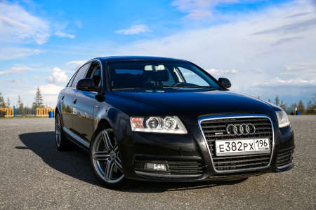 NOVYY URENGOY, RUSSIA - JUNE 20, 2017: Motor car Audi A6 at the countryside.
