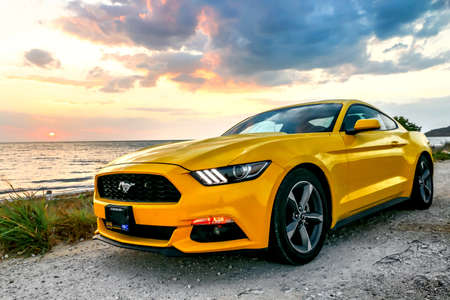 CAMPECHE, MEXICO - MAY 20, 2017: Yellow muscle car Ford Mustang at the countryside. Редакционное