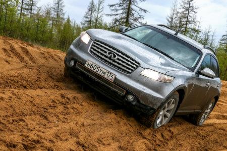 NOVYY URENGOY, RUSSIA - JUNE 19, 2017: Grey motor car Infiniti FX35 at the countryside.
