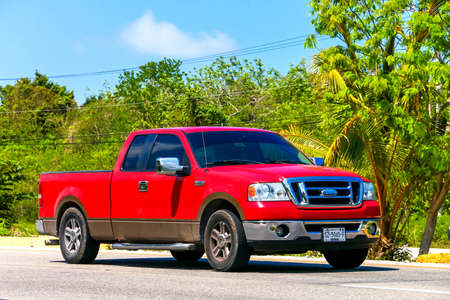 QUINTANA ROO, MEXICO - MAY 16, 2017: Red pickup truck Ford Lobo at the interurban road. Editorial