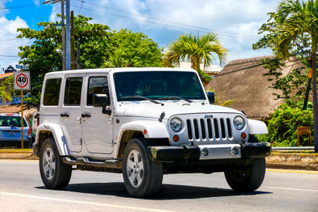 TULUM, MEXICO - MAY 17, 2017: Motor car Jeep Wrangler in the city street.