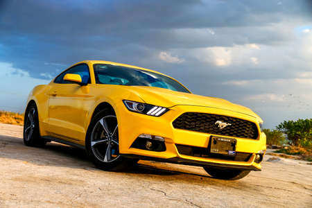 CAMPECHE, MEXICO - MAY 20, 2017: Yellow muscle car Ford Mustang at the countryside. 에디토리얼