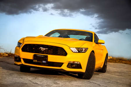 CAMPECHE, MEXICO - MAY 20, 2017: Yellow muscle car Ford Mustang at the countryside. Editorial