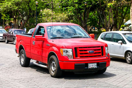 OAXACA, MEXICO - MAY 25, 2017: Red american pickup car Ford F150 in the city street.