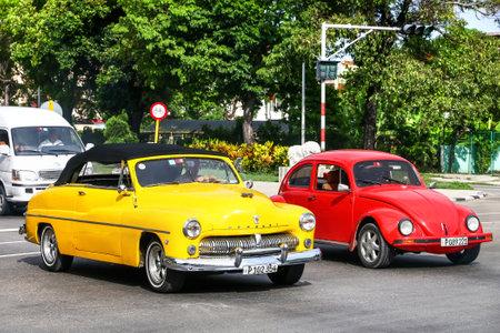 HAVANA, CUBA - JUNE 6, 2017: Motor cars Mercury Eight and Volkswagen Beetle in the city street.