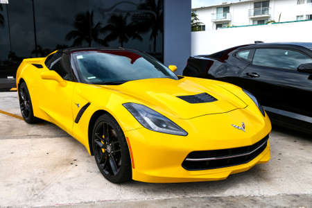CANCUN, MEXICO - JUNE 4, 2017: Yellow american sportscar Chevrolet Corvette in the city street.