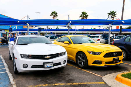 ACAPULCO, MEXICO - MAY 30, 2017: Sports cars Chevrolet Camaro and Ford Mustang in the city street. Editorial