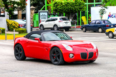 ACAPULCO, MEXICO - MAY 30, 2017: Sports car Pontiac Solstice in the city street.
