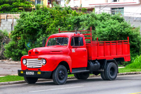 HAVANA, CUBA - JUNE 6, 2017: Red truck Ford F-series in the city street.