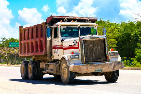 QUINTANA ROO, MEXICO - MAY 18, 2017: Dump truck Freightliner FLC at the interurban road. Editorial