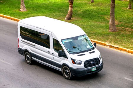 CANCUN, MEXICO - JUNE 3, 2017: White van Ford Transit in the city street.