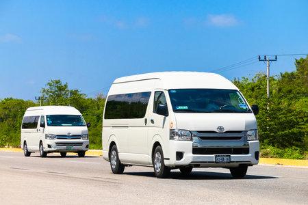 QUINTANA ROO, MEXICO - MAY 16, 2017: Passenger vans Toyota HiAce at the interurban road.