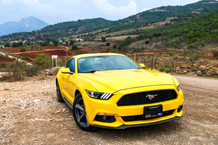 OAXACA, MEXICO - MAY 26, 2017: Yellow muscle car Ford Mustang at the countryside.