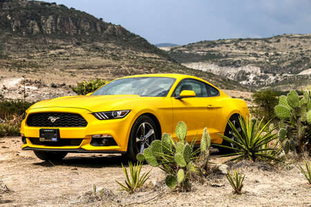 OAXACA, MEXICO - MAY 26, 2017: Yellow muscle car Ford Mustang in the desert. Editorial