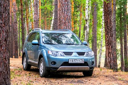 boles: CHELYABINSK REGION, RUSSIA - MAY 15, 2017: Motor car Mitsubishi Outlander at the countryside.