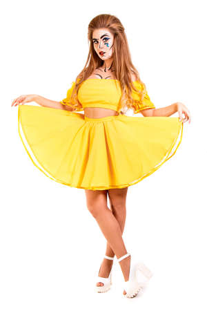 Young girl in a yellow dress isolated over white Stock Photo