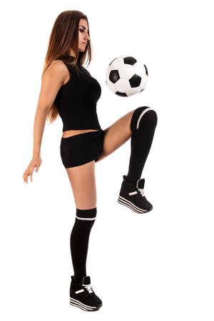 Beautiful young woman with a football isolated over white background