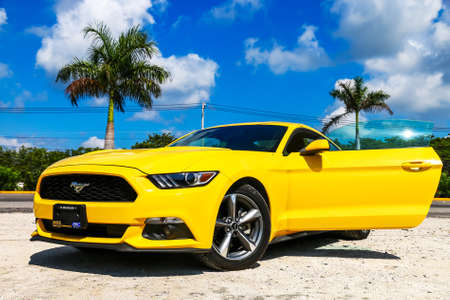 CANCUN, MEXICO - MAY 16, 2017: Modern yellow muscle car Ford Mustang at the countryside.