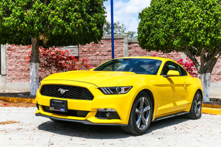MITLA, MEXICO - MAY 26, 2017: Yellow muscle car Ford Mustang at the countryside.