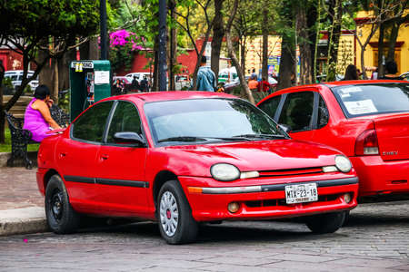 OAXACA, MEXICO - MAY 25, 2017: Red motor car Chrysler Neon in the city street.