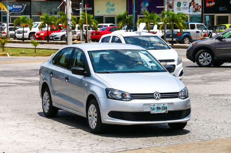 affordable: CANCUN, MEXICO - MAY 16, 2017: Motor car Volkswagen Vento in the city street.