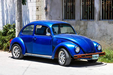 TULUM, MEXICO - MAY 17, 2017: Motor car Volkswagen Beetle in the city street.