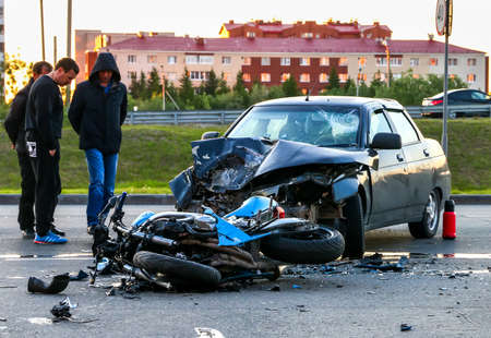 NOVYY URENGOY, RUSSIA - JULY 10, 2017: Accident with the cyan bike and car Lada 110 in the city street.