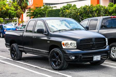 light duty: CANCUN, MEXICO - MAY 16, 2017: Black pickup truck Dodge Ram n the city street.