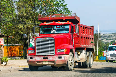GUERRERO, MEXICO - MAY 27, 2017: Red dump truck Freightliner FLD at the interurban road.